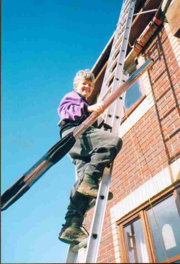 Clare carrying tubes up ladder